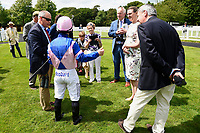 Jockey Sam Hitchcott talks to connections of Simply Breathless in the Parade ring during Afternoon Racing at Salisbury Racecourse on 13th June 2017