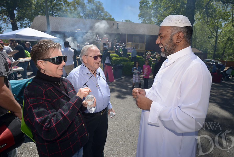 NWA Democrat-Gazette/BEN GOFF @NWABENGOFF<br /> Ila Blackketter-Wolfe and husband Rev. Darwin Wolfe, a retired Presbyterian minister, members of First Presbyterian Church of Bentonville, talk with Muhammed Khan, president of the Bentonville Islamic Center, Sunday, April 23, 2017, as participants in the Abraham Peace Walk gather for an open house at the Bentonville Islamic center following the walk. Members of Waterway Christian Church, First Christian Church of Bentonville, Congregation Etz Chaim and the Bentonville Islamic Center walked together across town from Waterway in a show of peace between Christianity, Judaism and Islam, which all trace their roots to the biblical patriarch Abraham.