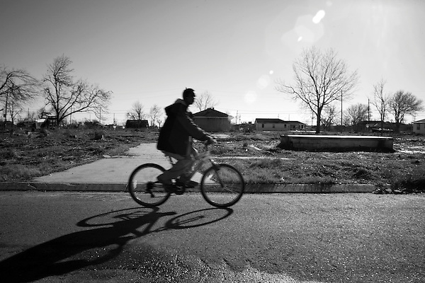 January 30, 2008. New Orleans, LA..  A man rides his bicycle though the still abandoned Lower 9th Ward of New Orleans on the eve of the 2nd Mardi Gras since Hurricane Katrina devastated the city,