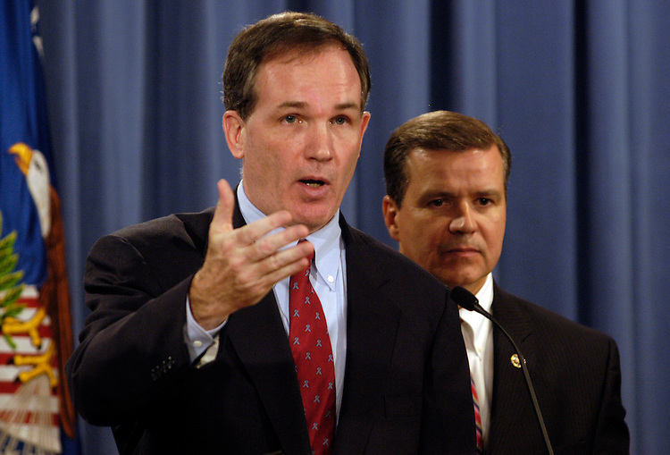 Special Counsel Patrick Fitzgerald and Special Agent John Eckenrode speak to the press about indictments from a CIA leak at the Department of Justice. Vice President Dick Cheney's chief of staff, Lewis Libby, resigned after being indicted on five counts including perjury, in the federal grand jury investigating the leak of covert CIA operative Valerie Plame's identity.