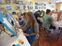NWA Democrat-Gazette/ANDY SHUPE<br /> Jill Smyth, 13, of Fayetteville paints a portrait of her goat, Skid, Saturday, June 30, 2018,, at Painting with a Twist in Fayetteville. The class, which allowed participants a chance to paint their pets, was the final class to be hosted at the business' Fayetteville location. Franchise owners plan to close the Fayetteville store and consolidate with their Bentonville location.