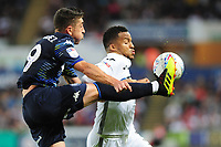 Pablo Hernandez of Leeds United vies for possession with Martin Olsson of Swansea City during the Sky Bet Championship match between Swansea City and Leeds United at the Liberty Stadium, Swansea, Wales, UK. Tuesday 21 August 2018
