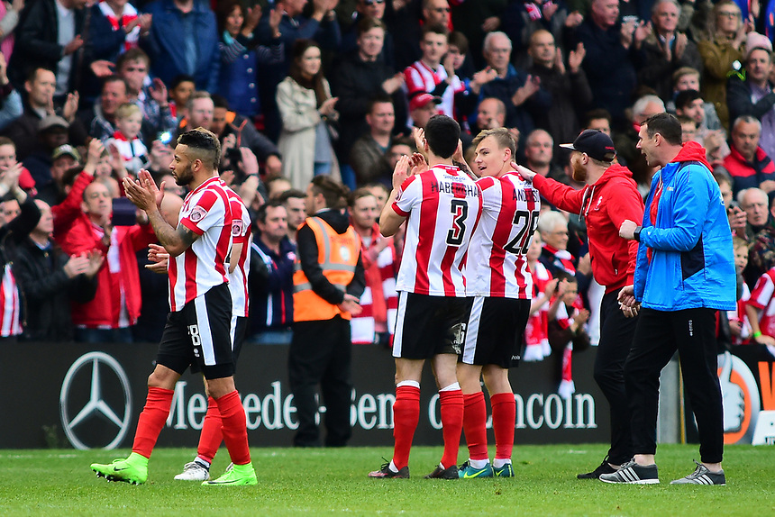 Lincoln City players celebrate the victory at the final whistle<br /> <br /> Photographer Andrew Vaughan/CameraSport<br /> <br /> Vanarama National League - Lincoln City v Torquay United - Friday 14th April 2016  - Sincil Bank - Lincoln<br /> <br /> World Copyright &copy; 2017 CameraSport. All rights reserved. 43 Linden Ave. Countesthorpe. Leicester. England. LE8 5PG - Tel: +44 (0) 116 277 4147 - admin@camerasport.com - www.camerasport.com