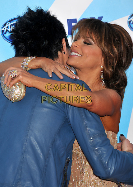 "ADAM LAMBERT & PAULA ABDUL.""American Idol"" Season 8 Finale - Arrivals held at the Nokia Theatre LA Live,  Los Angeles, CA, USA..May 20th, 2009.half length blue leather jacket gold jewel encrusted strapless dress hug embrace clutch bag.CAP/ADM/BP.©Byron Purvis/AdMedia/Capital Pictures."