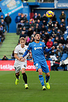 Getafe CF's Jorge Molina and Valencia CF's Daniel Wass during La Liga match between Getafe CF and Valencia CF at Coliseum Alfonso Perez in Getafe, Spain. November 10, 2018.
