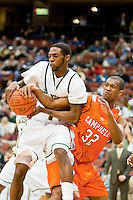 February 25, 2010:     Jacksonville guard Chris Edwards (15) fights Campbell guard/forward Miles Taylor (32) for a loose ball during Atlantic Sun Conference action between the Jacksonville Dolphins and the Campbell Camels at Veterans Memorial Arena in Jacksonville, Florida.  Jacksonville defeated Campbell 65-52.