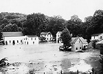 Wreckage piles up between houses in Washington Depot during the flood on August 19, 1955.