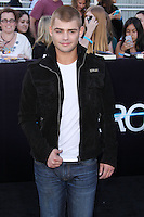 """WESTWOOD, LOS ANGELES, CA, USA - MARCH 18: Garrett Clayton at the World Premiere Of Summit Entertainment's """"Divergent"""" held at the Regency Bruin Theatre on March 18, 2014 in Westwood, Los Angeles, California, United States. (Photo by Xavier Collin/Celebrity Monitor)"""