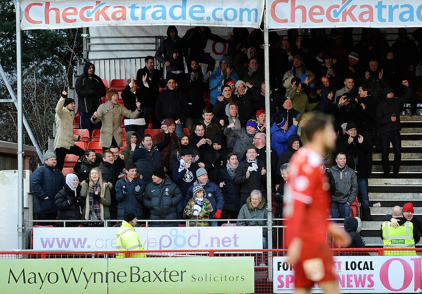 Preston North End fans celebrate the equaliser by Paul Huntington<br /> <br /> Photographer Ashley Western/CameraSport<br /> <br /> Football - The Football League Sky Bet League One - Crawley Town v Preston North End - Saturday 31st January 2015 - Broadfield Stadium - Crawley<br /> <br /> &copy; CameraSport - 43 Linden Ave. Countesthorpe. Leicester. England. LE8 5PG - Tel: +44 (0) 116 277 4147 - admin@camerasport.com - www.camerasport.com