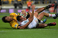 Aaron Cruden scores in the tackle of Sam Lousi during the Super Rugby match between the Hurricanes and Chiefs at Westpac Stadium in Wellington, New Zealand on Friday, 9 June 2017. Photo: Dave Lintott / lintottphoto.co.nz