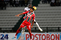 MANIZALES -COLOMBIA, 01-06-2013. Mauricio Casierra (I) del Once Caldas disputa el balón con César Granados (D) de Patriotas durante partido de la fecha 18 de la Liga Postobón 2013-1 jugado en el estadio Palogrande de Manizales./ Once Caldas' Player Mauricio Casierra (L) fights for the ball with Patriotas' players Cesar Granados (R) during match of the 18th date of Postobon  League 2013-1 at Palogrande stadium in Manizales. Photo: VizzorImage/Yonboni/STR