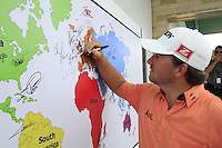 Graeme McDowell (NIR) signs the world map after finishing his round during Sunday's Final Round of the rain shortened 2011 Barclays Singapore Open, Singapore, 13th November 2011 (Photo Eoin Clarke/www.golffile.ie)