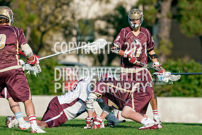 Los Angeles, CA 03/08/10 - Jon Yates (FSU # 11), Kelcey Fisher (LMU # 16) and Josh Hawes (FSU # 27) in action during the Florida State-LMU MCLA interconference men's lacrosse game at Leavey Field (LMU).  Florida State defeated LMU 12-7.