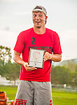 30 May 2015: Vermont Commons School Alum, Peter Larson, accepts an award for VCS to acknowledge school spirit after the conclusion of the Vermont Youth Ultimate League 2015 High School State Championships at Milton Senior High School in Milton, Vermont. Mandatory Credit: Ed Wolfstein Photo *** RAW (NEF) Image File Available ***