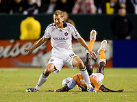 LA Galaxy defender Gregg Berhalter steals the ball from Houston Dynamo forward Dominic Oduro during the Western Conference Final. The LA Galaxy defeated the Houston Dynamo 2-1 to win the MLS Western Conference Final at Home Depot Center stadium in Carson, California on Friday November 13, 2009.....