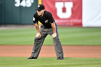 Umpire Nick Mahrley handles the calls on the bases during the Pacific Coast League game between the Salt Lake Bees and the El Paso Chihuahuas at Smith's Ballpark on August 7, 2014 in Salt Lake City, Utah.  (Stephen Smith/Four Seam Images)