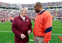 CHARLOTTESVILLE, VA- NOVEMBER 12: Virginia Tech Hokies head coach Frank Beamer, left, talks with Virginia Cavaliers head coach Mike London, right,  before the game on November 28, 2011 at Scott Stadium in Charlottesville, Virginia. Virginia Tech defeated Virginia 38-0. (Photo by Andrew Shurtleff/Getty Images) *** Local Caption *** Frank Beamer;Mike London