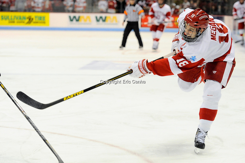 Boston University Terriers forward Wade Megan (18) passes during the third period of the Northeastern University at Boston University NCAA hockey match held at the Agganis Arena in Boston Massachusetts. Final score Northeastern University 6 Boston University 5  Eric Canha/CSM
