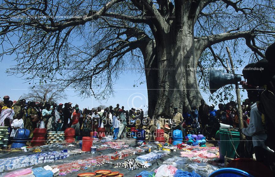 TANZANIA, market with cheap chinese products under Baobab tree in Meatu district / TANSANIA, Markt mit billigen chinesischen Waren unter Baobab Baum in einem Dorf