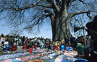 TANZANIA, market with cheap chinese products under Baobab tree in Meatu district / TANSANIA, Markt mit billigen chinesischen Waren unter Baobab Baum in einem Dorf