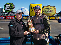 Feb 11, 2019; Pomona, CA, USA; NHRA top dragster driver John Taylor Jr (right) receives the trophy from Tom Bogner as he celebrates after winning the Winternationals at Auto Club Raceway at Pomona. Mandatory Credit: Mark J. Rebilas-USA TODAY Sports