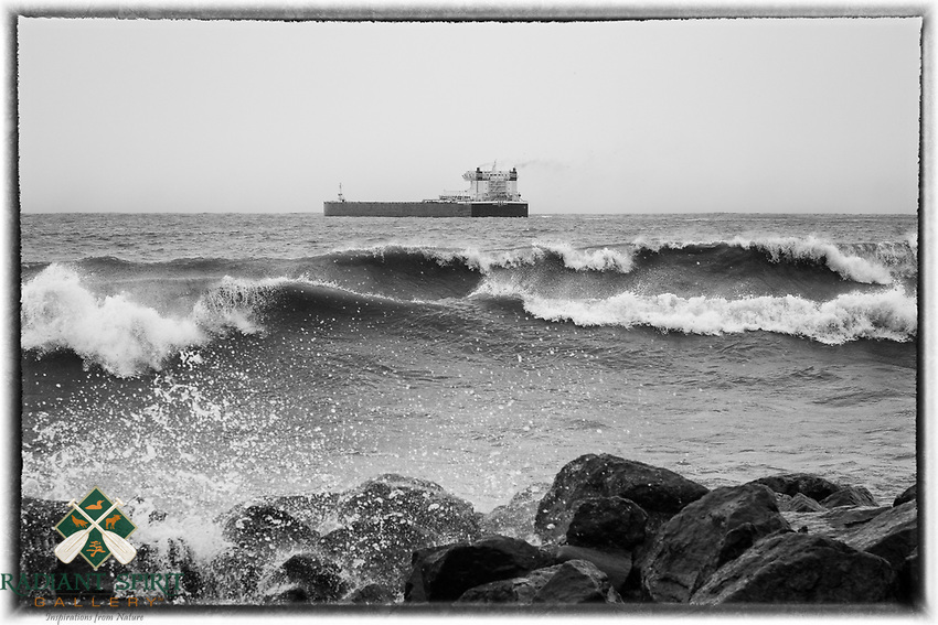 Stormy Departure<br /> The thousand footer, American Integrity, departed Duluth during the first winter storm of the season. This laker typically transports coal or iron ore on the Great Lakes, with a capacity of 78,850 tons.