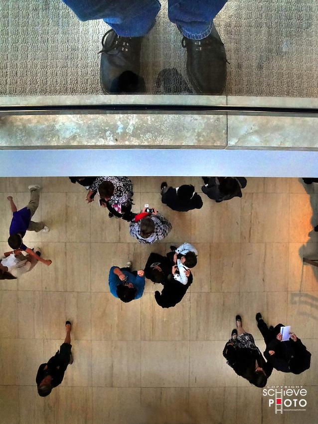 Feet and people below.