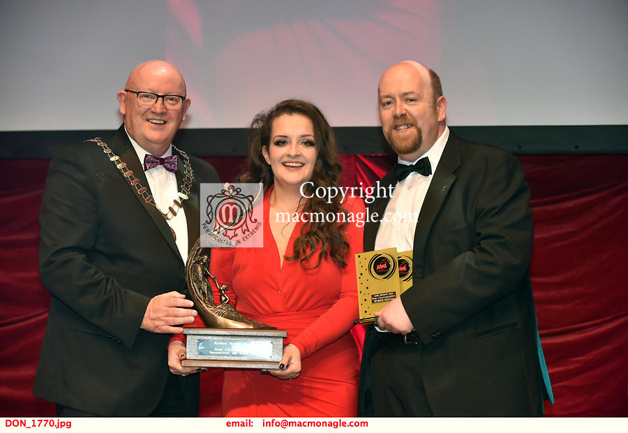 16-6-2019:  Meaddhbh Lyons and Anna Campbell- Pippin- GUMS, Galway winner of the Best Choreographer award at the annual AIMS (Association of Irish Musical Societies) in the INEC Killarney at the weekend receiving the trophy from Seamus Power, President, AIMS left and Rob Donnelly, Vice-President.<br /> Photo: Don MacMonagle - macmonagle.com<br /> <br /> repro free photo from AIMS<br /> <br /> AIMS PRESS RELEASE: There was plenty of glitz and glamour in Killarney on Saturday night as The Association of Irish Musical Societies has its Annual Awards Ceremony in Killarney. Over 1,500 people could be heard over the Kerry mountains as the winners were announced by MC Fergal D'Arcy. Many societies were double winners on the night including UCD Musical Society, Dublin were dancing all the way to the trophies winning Best Choreography and Best Choreographer for Leah Meagher for Cabaret and  Tullamore Musical Society who took their moment as Chris Corroon won Best Male Singer for his sinful performance as Henry Jekyll in Jekyll &Hyde and also Director Paul Norton who'd plenty to celebrate picking Best Director for  the same show. The moment was once again taken by Jekyll&Hyde by Dùn Laoighaire Musical&Dramatic Society as Kevin Hartnett took up Best Male Singer in the Sullivan category.Nenagh Youth Musical Society raised their voices high and took home Best Ensemble. It was a superior night for Enniscorthy Musical Society by winning Best Comedienne for Jennifer Byrne as Mother Superior and Best Technical too. Portlaoise Musical Society rose to the top by taking home Best Overall Show in the Gilbert section for their stunning production of Titanic. Oyster Lane Theatre Group, Wexford flew their flag high taking home Best Overall Show in the Sullivan Section for their breathtaking production of Michael Collins-a Musical Drama.<br /> Other winners on the night included Best Comedian for Ronan Walsh as Officer Lockstock in Urinetown for Trim Musical Society, Best Actress in a Suppo