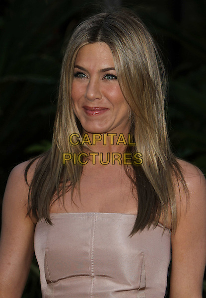 "JENNIFER ANISTON.""The Switch"" Los Angeles Premiere held at Arclight Cinemas, Hollywood, California, USA..August 16th, 2010.half length strapless beige nude smiling.CAP/ADM/CH.©Charles Harris/AdMedia/Capital Pictures"