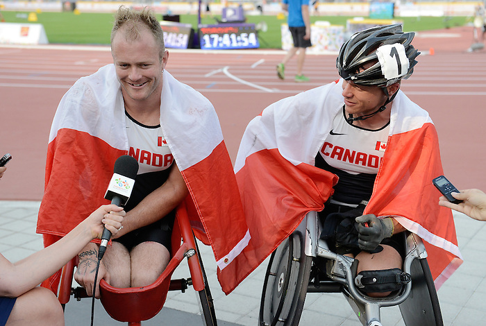 Toronto, ON - Aug 14 2015 - Alex Dupont and Joshua Cassidy talk to media after competing in the Men's 1500m T54 Final in the CIBC Athletics Stadium during the Toronto 2015 Parapan American Games  (Photo: Matthew Murnaghan/Canadian Paralympic Committee)