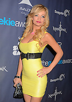 Mindy Robinson<br /> The first annual Geekie Awards at The Avalon Hollywood in Hollywood, CA., USA.  <br /> August 18th, 2013<br /> half length yellow dress hand on hip sleeveless black belt cleavage clutch bag<br /> CAP/ADM/BT<br /> &copy;Birdie Thompson/AdMedia/Capital Pictures