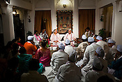 Indian Classical Maestros, Pt. Rajan and Sajan Mishra perform music to a small audience at The Ganges View Hotel, Varanasi in Uttar Pradesh, India. Photograph: Sanjit Das/Panos