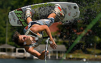 A wake boarder flips in the air while wake boarding on Lake Norman in the Charlotte, NC area.