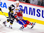 14 December 2009: Buffalo Sabres' left wing forward Matt Ellis (37) upends Montreal Canadiens' center Scott Gomez (91) in the second period at the Bell Centre in Montreal, Quebec, Canada. The Sabres defeated the Canadiens 4-3. Mandatory Credit: Ed Wolfstein Photo
