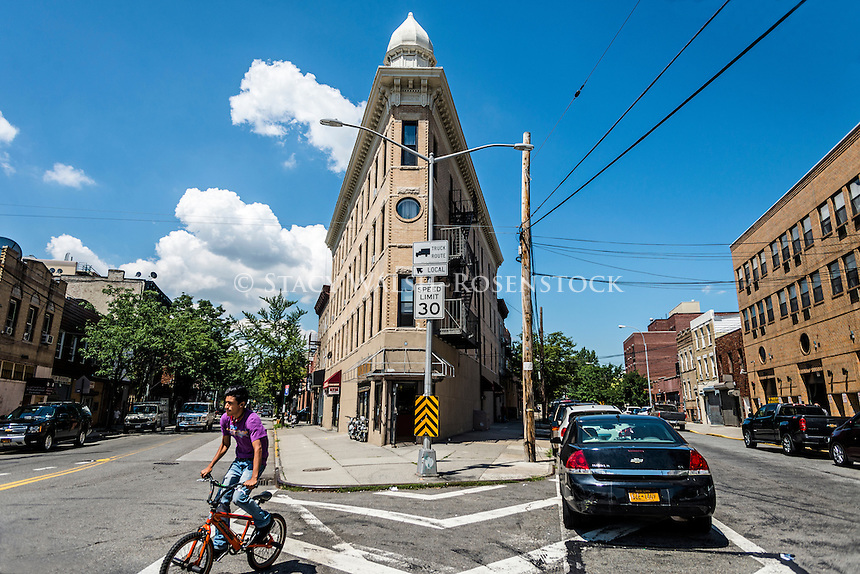 Astoria, Queens, New York - 3 August 2016 - Man on a bicycle in the old historic section of Astoria. ©Stacy Walsh Rosenstock