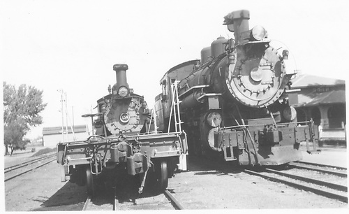 #456 with idler car on front and next to standard gauge locomotive #789.<br /> D&amp;RGW  Montrose, CO