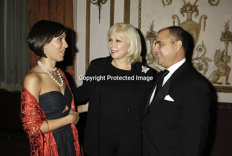 Cristina Saralegui and daughter Stephanie and husband Marcos Avila ..at The Broadcasting and Cable 15th Annual Hall of Fame..Awards Dinner at the Waldorf Astoria on October 24, 2005...The Awards are given by  Broadcasting and Cable Magazine.                                                                          Photo by Robin Platzer, Twin Images