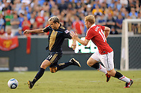 Eduardo Coudet (21) of the Philadelphia Union is marked by Paul Scholes (18) of Manchester United. Manchester United (EPL) defeated the Philadelphia Union (MLS) 1-0 during an international friendly at Lincoln Financial Field in Philadelphia, PA, on July 21, 2010.
