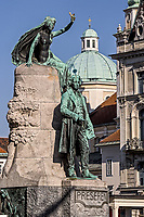 Statue of France Preseren, a Slovenian poet and national hero, and baroque-style Church of St. Nicholas, Preseren Square, Ljubljana, Slovenia