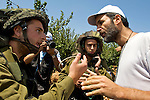 An Israeli soldier & activist argue during a non-violent demonstration in the West Bank village of Beit Ummar near Hebron on 10/07/2010.