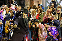 "Pictured: A festive character amuses the gathered crowds that gather to watch the Christmas parade in Swansea, Wales, UK. Sunday 19 November 2018<br /> Re: Swansea Christmas parade attended by thousands has been branded a ""shambles"" for having just three floats.<br /> The annual festive event in south Wales, which took place on Sunday, promised ""dynamic dance-troupes"" as well as ""spectacular shows and stages"".<br /> But the parade was scaled down, leading to a barrage of criticism on social media because of roadworks in the city centre. <br /> The leader of Swansea Council, Rob Stewart apologised on Facebook and said the parade was not ""good enough"".<br /> Parents took on social media to voice their anger, calling the event ""a load of rubbish"" and claiming there was nothing for young children apart from ""a loud music float with Santa on""."