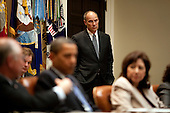 Washington, DC - June 9, 2009 -- Phil Schiliro, Assistant to the President for Legislative Affairs, looks on as United States President Barack Obama drops by a Green Cabinet meeting in the Roosevelt Room of the White House to discuss the importance of passing comprehensive energy legislation, June 9, 2009..Mandatory Credit: Pete Souza - White House via CNP