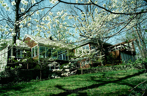 Exterior view of home with easy maintenace landcaping and spring blooms