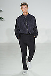 Model walks runway in a Spanish silk lounge jacket and side tab navy trouser, from the Palmiers du Mal Spring Summer 2017 collection by Brandon Capps and Shane Fonner, at Skylight Clarkson Square on July 14 2016, during New York Fashion Week Men's Spring Summer 2017.