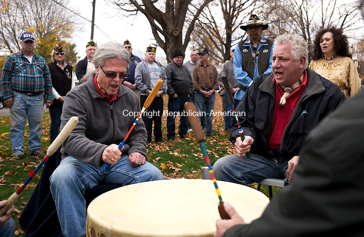 Middlebury, CT- 01 November 2015-110115CM03-  Members of the Quinnipiac Dancers, including Chris Fegan, left, and John Ralbovsky perform song during a Native American Veterans Blessing Ceremony on the Middlebury green on Saturday. The event which was co-sponsored by Middlebury Parks and Recreation and American Legion Oakville Post 195 featured drumming, dancing and singing.   Christopher Massa Republican-American