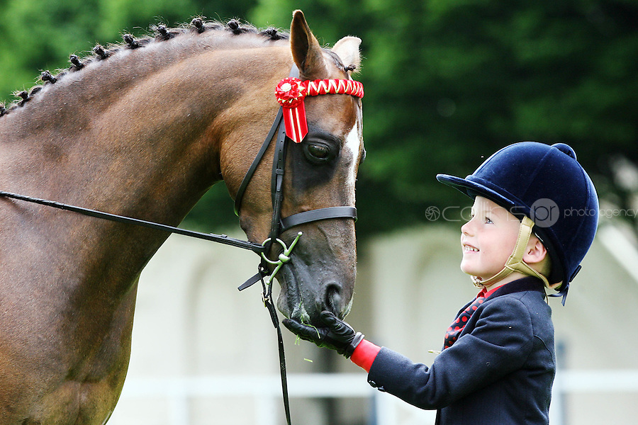 22/7/2010. Hugh O Connor aged 5 (one of the youngest competitors at this year's show) from Kildare and pony Lulu are pictured at the RDS for the launch of the 2010 Fáilte Ireland Dublin Horse Show. Picture James Horan/Collins Photos