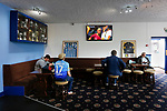 Fans watching England's women play New Zealand in the club bar. Yorkshire v Parishes of Jersey, CONIFA Heritage Cup, Ingfield Stadium, Ossett. Yorkshire's first competitive game. The Yorkshire International Football Association was formed in 2017 and accepted by CONIFA in 2018. Their first competative fixture saw them host Parishes of Jersey in the Heritage Cup at Ingfield stadium in Ossett. Yorkshire won 1-0 with a 93 minute goal in front of 521 people. Photo by Paul Thompson