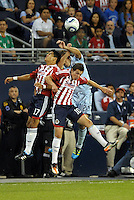 Jesus Sanchez (17) and Carlos Fierro (104) Chivas Guadalajara go up for a header with Davy Arnaud (22) Sporting KC... Sporting Kansas City played Chivas Guadalajara to a 2-2 tie at LIVESTRONG Sporting Park, Kansas City, Kansas in an international friendly.