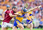 Podge Collins of Clare in action against Padraig Mannion of Galway during their All-Ireland semi-final replay at Semple Stadium,Thurles. Photograph by John Kelly.