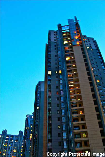 City living high rise apartment buildings blue sky photo